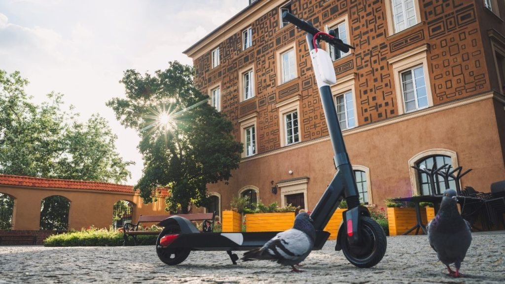 electric scooter is near to the building